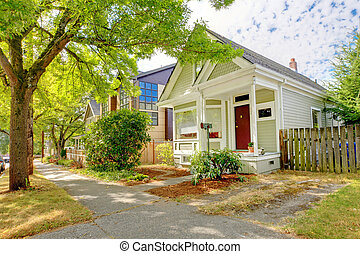 Small cute craftsman American house wth green and white. - ...