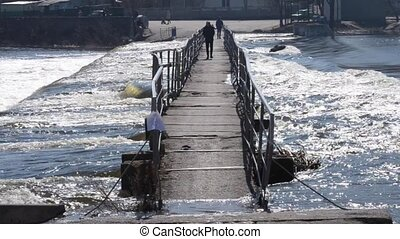 small dam bridge across the river. Ukraine