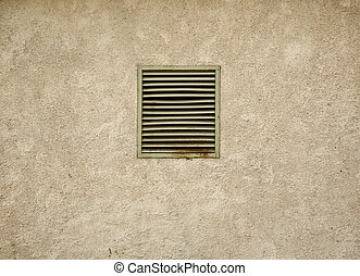 Small dark basement window with rusted steel lattice