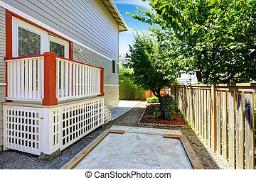 Small deck with white railings and orange trim