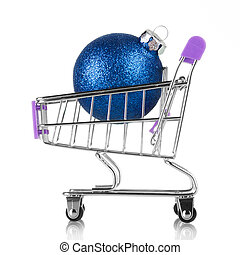 Small decorative shopping cart with blue christmas ball isolated on white