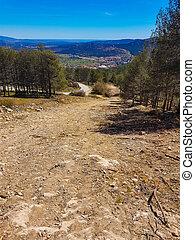 Small dirt road through a mountain