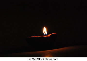 diya - small diya burning in the night