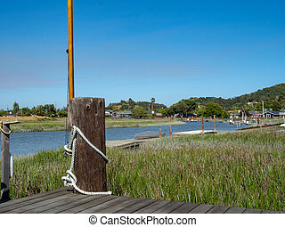 Small dock overlooking a clear sky and river in Marin County...