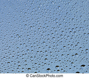 Small drops of water on glass surface