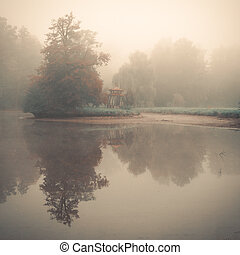 Small eastern arbour on a lake island in a foggy morning