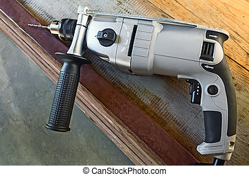 Small electric drill with a drill bit