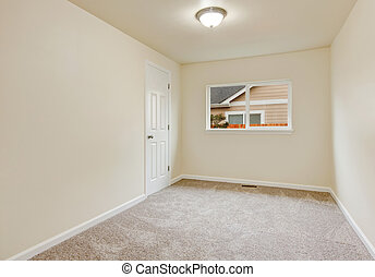 Small Empty Room In Warm Creamy Tones With Closet Window And Carpet