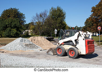 small excavator bobcat on the construction site