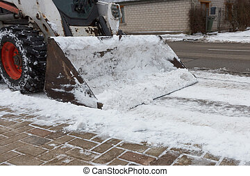 small excavator bobcat working on the street,
