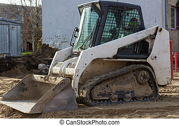small excavatot at construction site