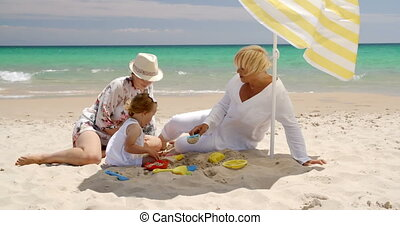 Small Family Having Fun at the Beach Sand
