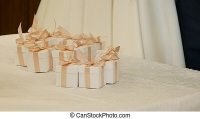 Small festive white boxes with gifts, slow mo, object,...