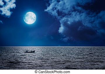 Small fisherman boat sailing on a full moon night