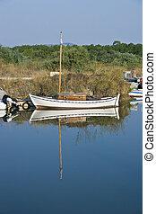 small fishing boat at a river