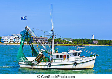 small fishing boat heading out