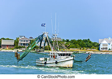 small fishing boat heading out to the ocean