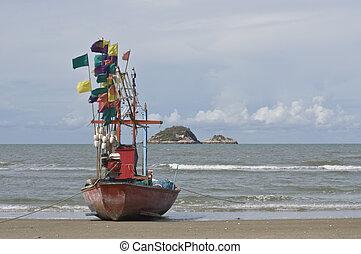 small fishing boat on Hua Hin beach,Thailand