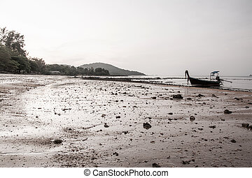 small fishing boat on the beach in the evening