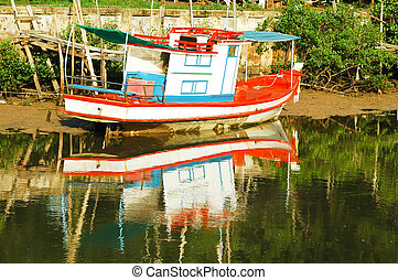 Small fishing boat on the river.