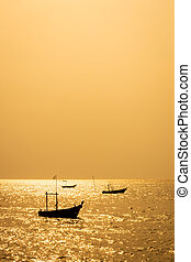 small fishing boat on the sea at sunset