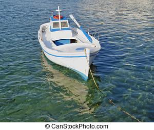 small fishing boat,  turquoise sea