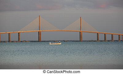 Small fishing boat under the Sunshine Skyway Bridge - Florida