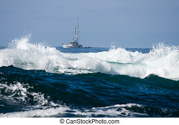 Small fishing boat with surf