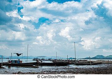 Small fishing boats in dam