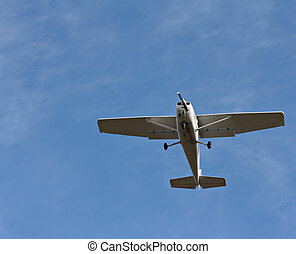 Small fixed wing plane against a clear blue sky