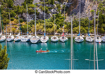 Small fjord in Calanque - White sailboats moored in rows ...