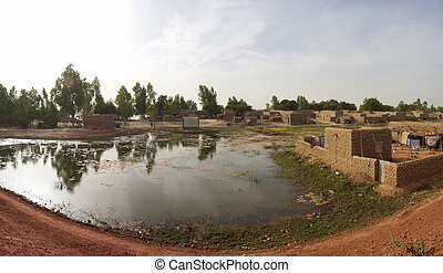Small flooded village in Mali - Panorama of a flooded ...