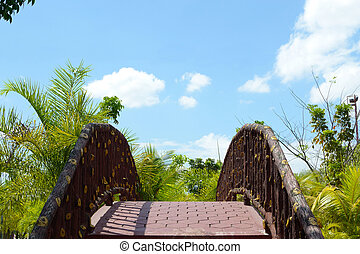 small foot-bridge in the middle of a garden.