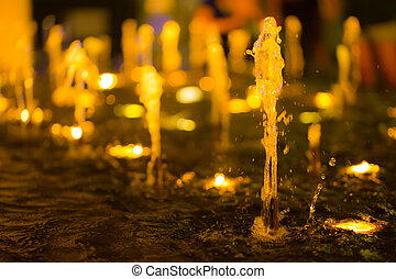 Small fountain at night blur for background.