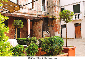 Small garden in the courtyard of the Italian city