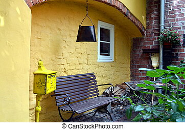 small garden with bench in summertime