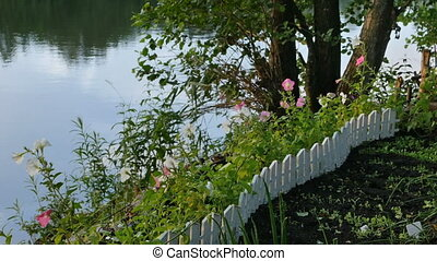 garden with flowers on the shore - small garden with flowers...