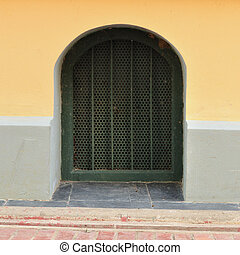 Small gate in building wall