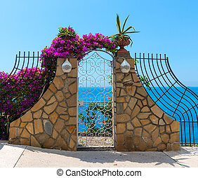 Small gates by the cliff on a clear day in Positano