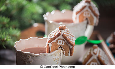 Small gingerbread cottages with hot chocolate for Christmas