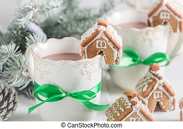 Small gingerbread cottages with sweet drink for Christmas