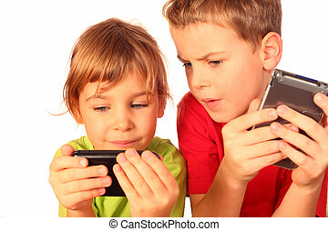 small girl and boy write messages to each other and compare telephones