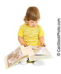 Small girl browsing an family album