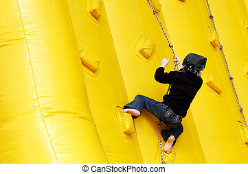 small girl climbing on the rubber hill