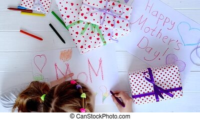 Small girl drawing a greeting card - Little girl drawing...
