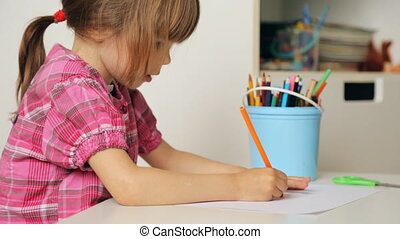 Small girl drawing with colourful pencils