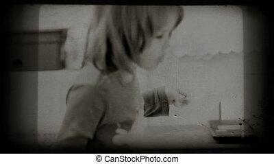Small girl eats spaghetti, vintage 8 mm footage.