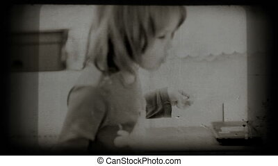 Small girl eats spaghetti, vintage