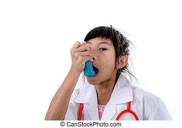 Small girl in doctor's coat inhaling medicine