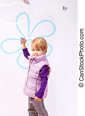 Small girl in pink vest with toy airplane